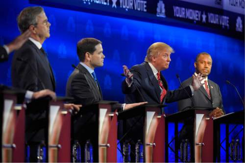 Donald Trump, second from right, speaks, as Jeb Bush, left, Marco Rubio, second from left, and Ben Carson look on during the CNBC Republican presidential debate at the University of Colorado, Wednesday, Oct. 28, 2015, in Boulder, Colo. (AP Photo/Mark J. Terrill)