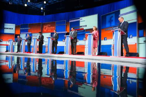 Republican presidential candidates from left, Jim Gilmore, Lindsey Graham, Bobby Jindal, Rick Perry, Rick Santorum, Carly Fiorina, and George Pataki participate in a pre-debate forum at the Quicken Loans Arena, Thursday, Aug. 6, 2015, in Cleveland. Seven of the candidates have not qualified for the primetime debate. (AP Photo/John Minchillo)