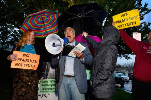Scott Sommerdorf   |  The Salt Lake Tribune Salt Lake County District Attorney Sim Gill speaks at a protest outside the Grand America Hotel and prior to a march by LGBT activist and allies, including Jackie  Biskupski, and Mark Lawrence, Thursday, October 29, 2015.