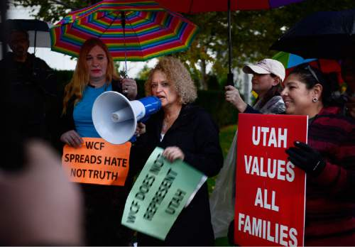 Scott Sommerdorf   |  The Salt Lake Tribune Jackie  Biskupski speaks at a protest outside the Grand America Hotel and prior to a march by LGBT activist and allies, including Salt Lake County District Attorney Sim Gill, and Mark Lawrence, Thursday, October 29, 2015.
