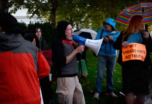 Scott Sommerdorf   |  The Salt Lake Tribune Restore Our Humanity founder Mark Lawrence speaks at a protest outside the Grand America Hotel and prior to a march by LGBT activist and allies, including Salt Lake County District Attorney Sim Gill, and Jackie  Biskupski, Thursday, October 29, 2015.