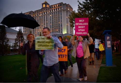 Scott Sommerdorf   |  The Salt Lake Tribune Protestors march by the Grand America Hotel as they protest the World Council of Families. Jackie  Biskupski, Sim Gill, and Mark Lawrence spoke prior to the march around the hotel, Thursday, October 29, 2015.