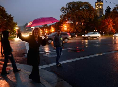 Scott Sommerdorf      The Salt Lake Tribune  Mayoral candidate Jackie  Biskupski pauses to encourage protestors as she leaves a march by LGBT activists and allies, as she is about to cross State Street near the City and County Building, Thursday, October 29, 2015.