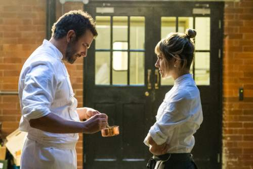 """This photo provided by The Weinstein Company, shows Bradley Cooper, left, as Adam Jones, and Sienna Miller as Helene, in a scene from the film, """"Burnt.""""  The movie opens nationwide Oct. 30. (Alex Bailey/The Weinstein Company via AP)"""