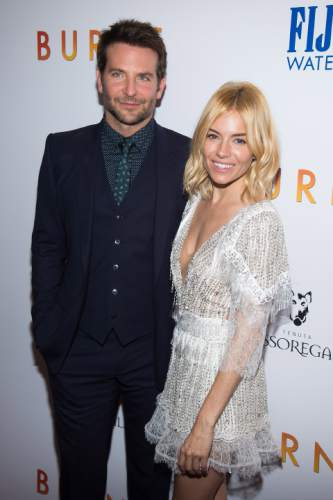 """FILE - In this Tuesday, Oct. 20, 2015 file photo, Bradley Cooper, left, and Sienna Miller, attends the premiere of """"Burnt"""" at the Museum of Modern Art, in New York. The movie opens nationwide on Oct. 30. (Photo by Charles Sykes/Invision/AP, File)"""
