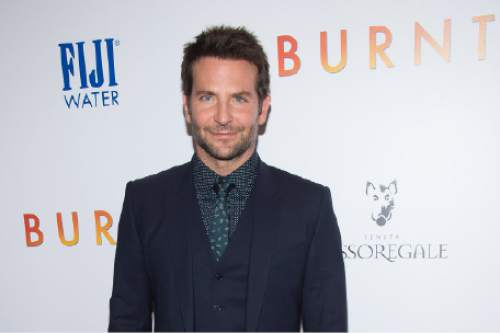 """FILE - In this Tuesday, Oct. 20, 2015 file photo, Bradley Cooper attends the premiere of """"Burnt"""" at the Museum of Modern Art, in New York. Cooper wasn't a novice to the kitchen when he decided to take on the role of the fictional Michelin star chef Adam Jones in """"Burnt."""" But he didn't tell anyone that when he started rubbing elbows with the Michelin caliber cooks he needed to learn from for this role. (Photo by Charles Sykes/Invision/AP, File)"""