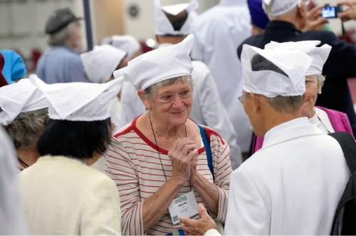 Al Hartmann  |  The Salt Lake Tribune Participants at the Parliament of the World's Religions talk and wear obligatory head coverings while waiting to be seated and served food at a traditional Langar.  Langar is a 500-year-old Sikh religion tradition where vegetarian food is served to all for free, regardless of religion or class.  Langar expresses the ideals of community, sharing and oneness of mankind. Several thousand sat together as equals on the floor of the Salt Palace Convention Center Friday, Oct. 16 and were served by dozens of Sikh volunteers.