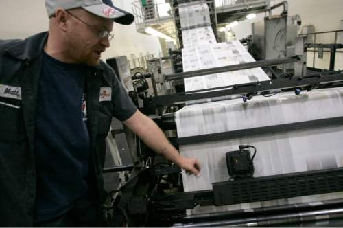 |  Tribune File Photo  Journeyman pressman Matt Larsen monitors the USA Today printing on the TKS press Wednesday, March 11, 2009 at MediaOne in West Valley City. MediaOne prints many papers and products including The New York Times, USA Today, The Deseret News, Provo Daily Herald and The Salt Lake Tribune.
