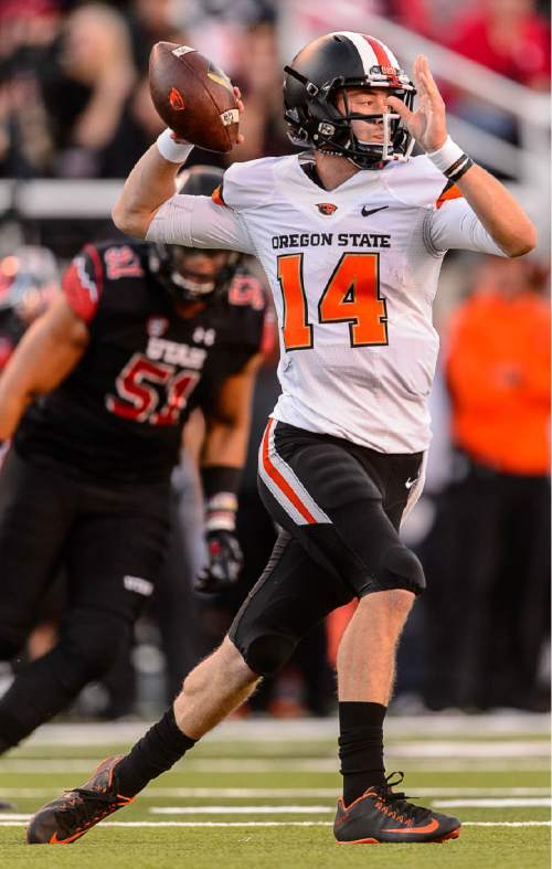 Trent Nelson  |  The Salt Lake Tribune Oregon State Beavers quarterback Nick Mitchell (14) throws the ball as the University of Utah hosts Oregon State, NCAA football at Rice-Eccles Stadium in Salt Lake City, Saturday October 31, 2015.