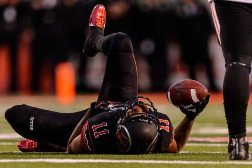 Trent Nelson  |  The Salt Lake Tribune Utah Utes wide receiver Raelon Singleton (11) on the ground after a hard hit as the University of Utah hosts Oregon State, NCAA football at Rice-Eccles Stadium in Salt Lake City, Saturday October 31, 2015.