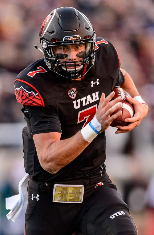 Trent Nelson  |  The Salt Lake Tribune Utah Utes quarterback Travis Wilson (7) runs the ball as the University of Utah hosts Oregon State, NCAA football at Rice-Eccles Stadium in Salt Lake City, Saturday October 31, 2015.