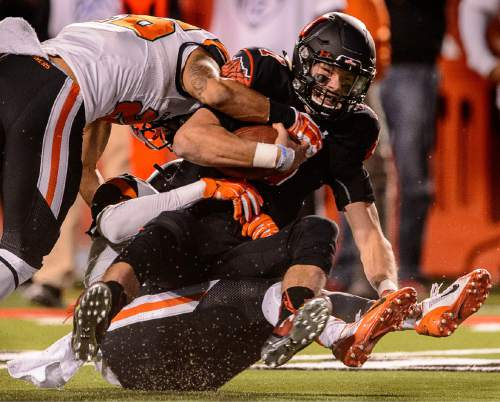 Trent Nelson  |  The Salt Lake Tribune Utah Utes quarterback Travis Wilson (7) is sacked by Oregon State defenders as the University of Utah hosts Oregon State, NCAA football at Rice-Eccles Stadium in Salt Lake City, Saturday October 31, 2015.