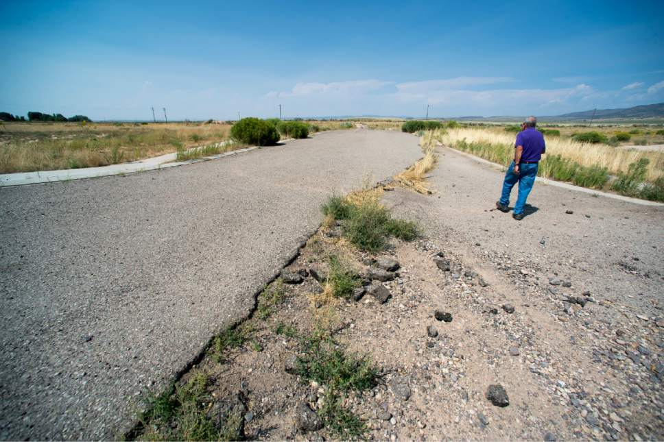 Rick Egan  |  The Salt Lake Tribune  Bill Lund, senior scientist for the Utah Geological survey, talks about the dangers of the falling water table, as he points out a fissure that stopped a subdivision from being built near Enoch, Thursday, August 20, 2015.