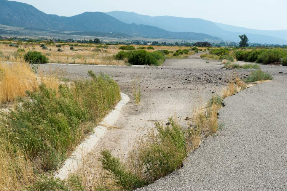 Rick Egan  |  The Salt Lake Tribune  A subdivision near Enoch was halted, because of a fissure that appeared 7 years ago. Thursday, August 20, 2015.