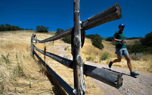 Steve Griffin  |  The Salt Lake Tribune  Chris Jones makes his way along the Bonneville Shoreline Trail near the mouth of Emigration Canyon in Salt Lake City, Monday, Aug. 31, 2015.