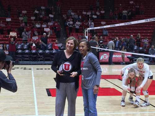 University of Utah volleyball coach Beth Launiere accepts an award following her 500th victory for the Utes program.   Matthew Piper | The Salt Lake Tribune