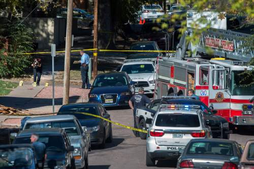 Police investigate the scene after a shooting Saturday, Oct. 31, 2015, in Colorado Springs, Colo. Multiple are dead, including a suspected gunman, following a shooting spree according to authorities. Lt. Catherine Buckley said the crime scene covers several major downtown streets. (Christian Murdock/The Gazette via AP) MAGS OUT; MANDATORY CREDIT