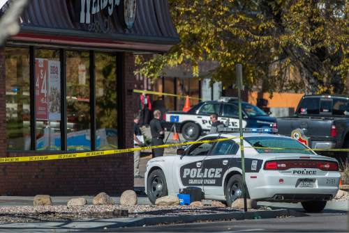 The rear window of a Colorado Springs Police car is shattered after a shooting Saturday, Oct. 31, 2015, in Colorado Springs, Colo. Multiple are dead, including a suspected gunman, following a shooting spree according to authorities. Lt. Catherine Buckley said the crime scene covers several major downtown streets. (Christian Murdock/The Gazette via AP) MAGS OUT; MANDATORY CREDIT