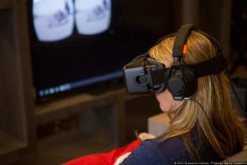 Abbey Hoekzema  |  Sundance Institute  A visitor to the 2015 Sundance Film Festival's New Frontier installation site in Park City wears an Oculus Rift headset to sample a virtual-reality immersion experience.
