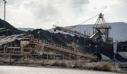 Francisco Kjolseth  |  The Salt Lake Tribune  Coal is piled up at the Levan transfer facility along Interstate 15--south of Nephi. Utah Community Impact Board awarding a $50 million loan to four coal-producing counties to build a deep-water port in Oakland, Calif. that would be a shipping point for Utah coal. We want to illustrate Utah's current coal industry chain and points that might have between 1 and 3 million tons of coal moving through them in the future.