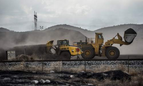 Francisco Kjolseth  |  The Salt Lake Tribune  Crews move coal at the Levan transfer facility along Interstate 15--south of Nephi where a steady flow of trucks unload it before it is transferred to train cars. Utah Community Impact Board awarding a $50 million loan to four coal-producing counties to build a deep-water port in Oakland, Calif. that would be a shipping point for Utah coal. We want to illustrate Utah's current coal industry chain and points that might have between 1 and 3 million tons of coal moving through them in the future.