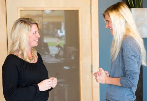 Rick Egan  |  The Salt Lake Tribune Ann Marie Wallace (right)  gives some advice to  to Abbey Daw (left), owner of Sweat & Soul Yoga, Thursday, October 29, 2015. Ann Marie Wallace graduated from Utah State University in the 1990's, when the state's women were closing in on a gender gap in higher education. Since then, men have outpaced women when it comes to earning bachelor's degrees. Wallace, for her part, coaches women entrepreneurs on how to start and grow their businesses as a program director Salt Lake Area Chamber of Commerce.