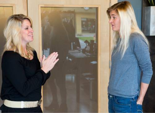 Rick Egan  |  The Salt Lake Tribune  Ann Marie Wallace (left)  gives some advice to  to Abbey Daw (right), owner of Sweat & Soul Yoga, Thursday, October 29, 2015. Ann Marie Wallace coaches women entrepreneurs on how to start and grow their businesses.