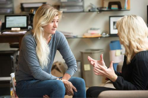 Rick Egan  |  The Salt Lake Tribune  Ann Marie Wallace (right)  gives some advice to  to Abbey Daw (left), owner of Sweat & Soul Yoga, Thursday, October 29, 2015. Ann Marie Wallace coaches women entrepreneurs on how to start and grow their businesses.