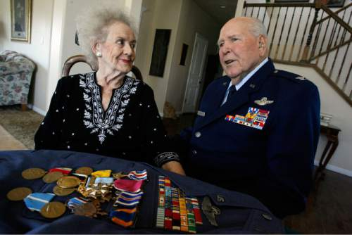 "Francisco Kjolseth  |  The Salt Lake Tribune  Emmett ""Cyclone"" Davis , 92, a former World War II pilot recalls the words he spoke to Marjorie when he proposed. The two have been married for 65 years. ""Cyclone"" was in the war from Pearl Harbor until the Japanese surrendered, flying missions throughout the Pacific theater. He won many medals, including the Silver Star and Distinguished Flying Cross."