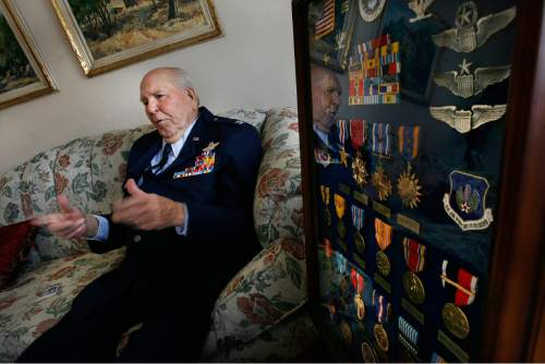 "Scott Sommerdorf  |  The Salt Lake Tribune                Emmett ""Cyclone"" Davis speaks about his career in his Highland home Thursday, December 6, 2012, next to a frame of the medals he has collected during his career as a pilot. Davis, a native of Roosevelt, was a young pilot in the Army Air Corps, based at Wheeler Field in Hawaii, when the Japanese attacked Pearl Harbor on Dec. 7, 1941. He was one of the few pilots able to get into the air in an attempt to defend Pearl Harbor."