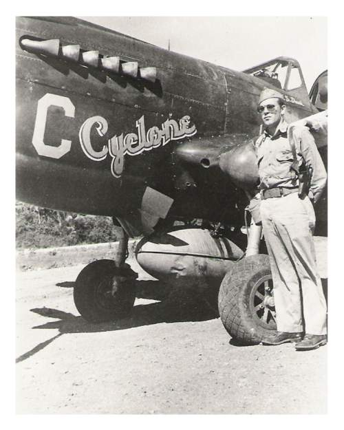 |  Courtesy Tucker Davis  Emmett 'Cyclone' Davis in front of his P-40 (this is the plane in which he shot down all of his enemy planes.  This photo was taken at Three-Mile, in New Guinea, in the fall of 1943.