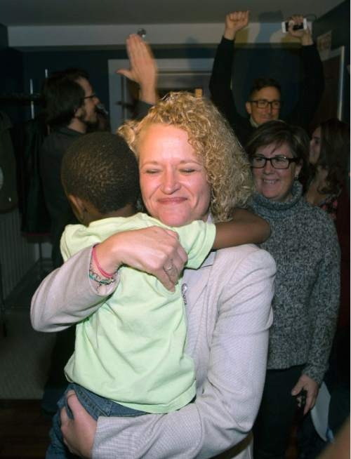 Steve Griffin  |  The Salt Lake Tribune  Jackie Biskupski's hugs her son Archie after seeing election results for the first time at her election night gathering at Kimi's Chop House in Salt Lake City, Tuesday, November 3, 2015.