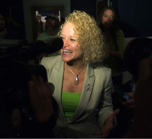 Steve Griffin  |  The Salt Lake Tribune  Jackie Biskupski's smiles as she talks with reporters after seeing election results for the first time at her election night gathering at Kimi's Chop House in Salt Lake City, Tuesday, November 3, 2015.