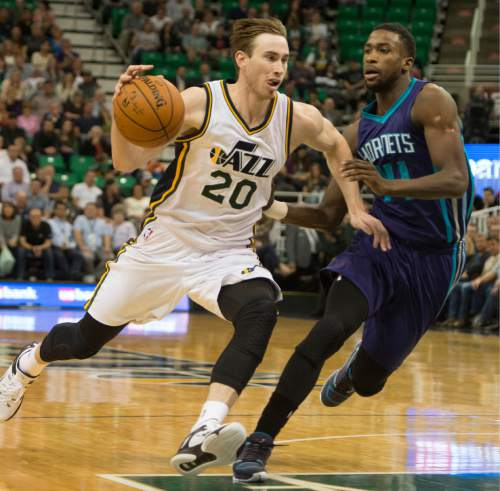 Rick Egan  |  The Salt Lake Tribune  Utah Jazz forward Gordon Hayward (20) takes the ball down court, as Charlotte Hornets forward Michael Kidd-Gilchrist (14) defends, in NBA action Utah Jazz vs. The Charolette Hornets, in Salt Lake CIty, Monday, March 16, 2015