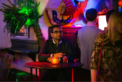 "In this image released by Netflix, Aziz Ansari appears in a scene from the Netflix original series ""Master of None."" The comedy series premieres on Friday. (K.C. Bailey/Netflix via AP)"