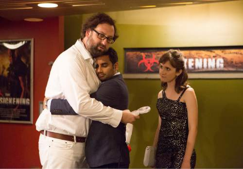 "In this image released by Netflix, from left, Eric Wareheim, Aziz Ansari and Noel Wells appear in a scene from the Netflix original series ""Master of None."" The comedy series premieres on Friday. (K.C. Bailey/Netflix via AP)"