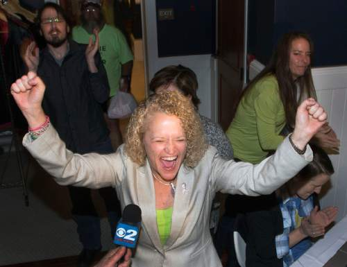 Steve Griffin  |  The Salt Lake Tribune  Jackie Biskupski's raises her arms and screams with excitement as she sees election results for the first time at her election night gathering at Kimi's Chop House in Salt Lake City, Tuesday, November 3, 2015.