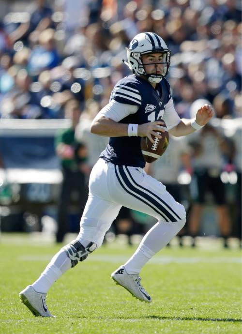 BYU quarterback Tanner Mangum (12) carries the ball as he runs downfield in the first half during an NCAA college football game against Wagner Saturday, Oct. 24, 2015, in Provo, Utah. (AP Photo/Rick Bowmer)