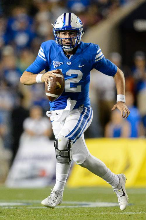 Trent Nelson     The Salt Lake Tribune Brigham Young Cougars quarterback Tanner Mangum (12) scrambles as BYU hosts East Carolina, college football at LaVell Edwards Stadium in Provo, Saturday October 10, 2015.