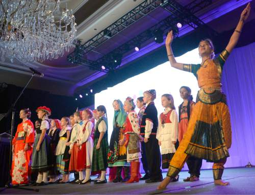 Al Hartmann  |  The Salt Lake Tribune Members of the International Children's Choir dressed in their country's traditional clothing sing in the March of the National Flags. The choir performed during the opening of four-day World Congress of Families at the Grand America hotel in Salt Lake City Tuesday Oct. 27, 2015.