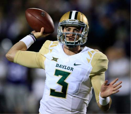 Baylor quarterback Jarrett Stidham (3) passes to a teammate during the first half of an NCAA college football game against Kansas State in Manhattan, Kan., Thursday, Nov. 5, 2015. (AP Photo/Orlin Wagner)