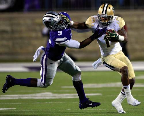 Baylor wide receiver Corey Coleman (1) gets away from Kansas State linebacker Elijah Lee (9) during the first half of an NCAA college football game in Manhattan, Kan., Thursday, Nov. 5, 2015. (AP Photo/Orlin Wagner)