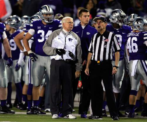 Kansas State head coach Bill Snyder, front left, requests a timeout from head linesman Bill Scott during the first half of an NCAA college football game against Baylor in Manhattan, Kan., Thursday, Nov. 5, 2015. (AP Photo/Orlin Wagner)
