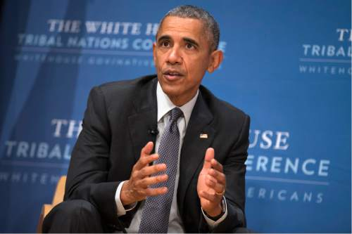 President Barack Obama speaks during the 2015 White House Tribal Nations Conference, on Thursday, Nov. 5, 2015, in Washington. In conjunction with the conference, shoe company and apparel maker Adidas announced it will provide free design resources to schools looking to shelve Native American mascots, nicknames, imagery or symbolism. (AP Photo/Evan Vucci)