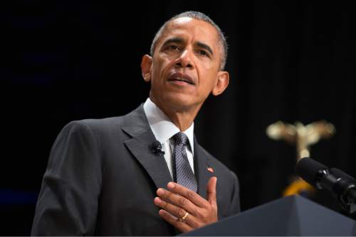 President Barack Obama speaks at the 2015 White House Tribal Nations Conference,  Thursday, Nov. 5, 2015, in Washington. In conjunction with the conference, shoe company and apparel maker Adidas announced it will provide free design resources to schools looking to shelve Native American mascots, nicknames, imagery or symbolism. (AP Photo/Evan Vucci)