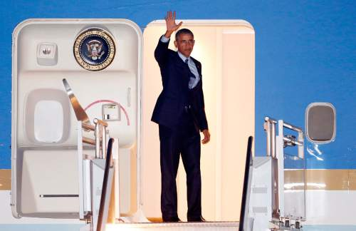 President Barack Obama boards Air Force One prior to flying back to Washington after a visit to New Jersey and New York, Monday, Nov. 2, 2015, in Newark, N.J. (AP Photo/Julio Cortez)