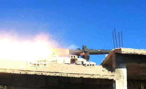 In this photo released on September 6, 2015, and provided by the Fursan al-Haq Syrian rebel brigade, which has been authenticated based on its contents and other AP reporting, a Free Syrian Army fighter of Fursan al-Haq brigade fires U.S.-made anti-tank Tow missile, at Azzan village, in the country side of Aleppo province, Syria. TDespite a month of heavy battering by Russian airstrikes, Syria's rebels have so far been able to fend off offensives by government forces trying to retake territory from the rebel's heartland. The fierce fighting shows how even greater backing from Syrian President Bashar Assad's international allies is not swiftly tipping the conflict in his favor. (Fursan al-haq Rebel Brigade via AP)