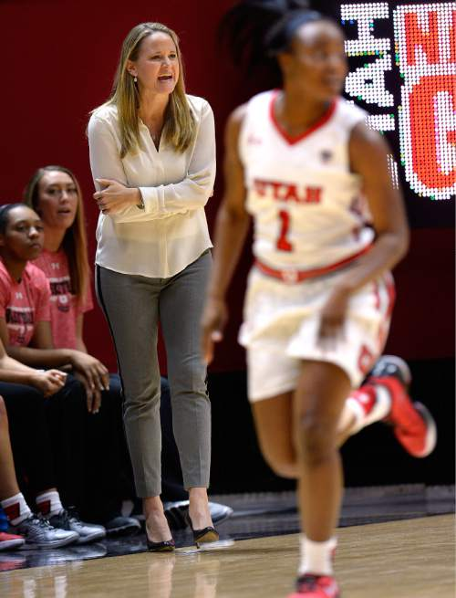 Scott Sommerdorf   |  The Salt Lake Tribune Utah women's basketball head coach Lynne Roberts yells instructions to her team as she watches first half play against Fort Lewis College. Utah led Fort Lewis 46-32 at the half, Friday, November 6, 2015.