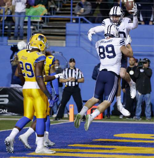 BYU's Mitch Mathews (10) celebrates his touchdown with teammate Tanner Balderree (89) during the first half of an NCAA college football game against San Jose State on Friday, Nov. 6, 2015, in San Jose, Calif. (AP Photo/Marcio Jose Sanchez)