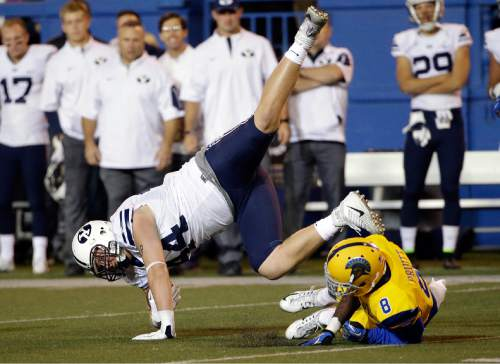 BYU's Remington Peck, left, leaps over San Jose State cornerback Jimmy Pruitt (8) after a catch during the first half of an NCAA college football game Friday, Nov. 6, 2015, in San Jose, Calif. (AP Photo/Marcio Jose Sanchez)